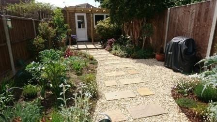 A Mediterranean influenced garden with access to gym